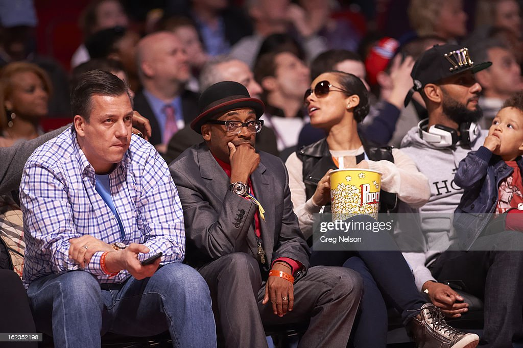 Celebrities film director Spike Lee, musician Alicia Keys, and her husband, record producer Swizz Beats seated courtside during All-Star Weekend at Toyota Center. Greg Nelson F35 )