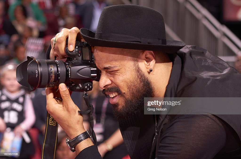 Closeup of New York Knicks Tyson Chandler taking photographs from sidelines during All-Star Weekend at Toyota Center. Greg Nelson F46 )