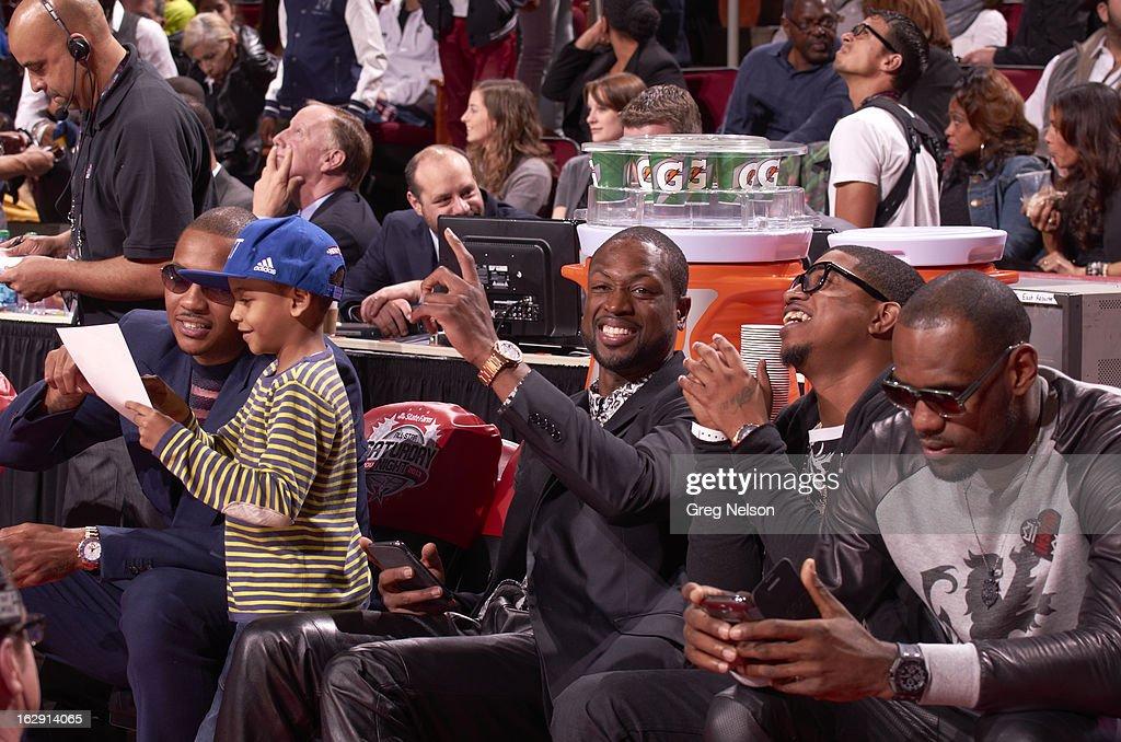 New York Knicks Carmelo Anthony and son, Kiyan Carmelo Anthony, Miami Heat Dwyane Wade and LeBron James on sidelines during All-Star Weekend at Toyota Center. Greg Nelson F18 )