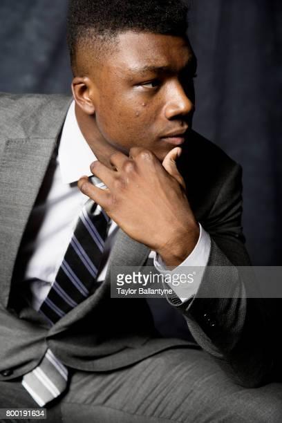 NBA Draft Closeup portrait of Los Angeles Lakers No 42 pick Thomas Bryant posing during photo shoot after selection process at Barclays Center Behind...