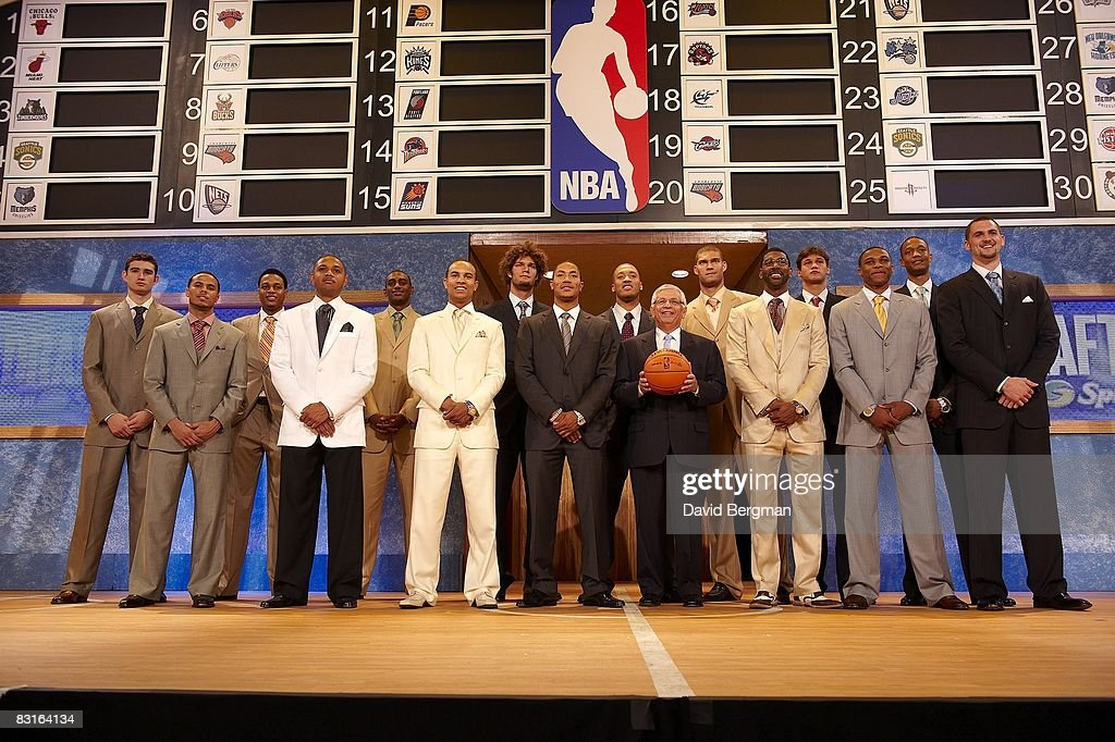 NBA commissioner David Stern (with ball) posing with draftees (L-R) Joe Alexander, D.J. Augustin, Brandon Rush, Eric Gordon, Darrell Arthur, Jerryd Bayless, Robin Lopez, Derrick Rose, Michael Beasley, O.J. Mayo, Brook Lopez, Danilo Galinari, Russell Westbrook,Anthony Randolph and Kevin Love before draft at Madison Square Garden. New York, NY 6/26/2008