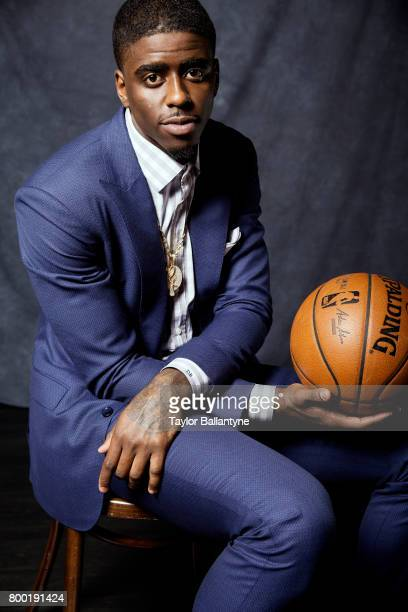 NBA Draft Portrait of Charlotte Hornets No 40 pick Dwayne Bacon posing during photo shoot after selection process at Barclays Center Behind the...