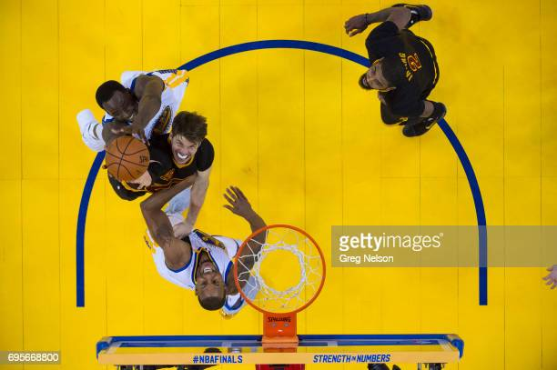 NBA Finals Aerial view Cleveland Cavaliers Kyle Korver in action shot vs Golden State Warriors Andre Iguodala at Oracle Arena Game 5 Oakland CA...