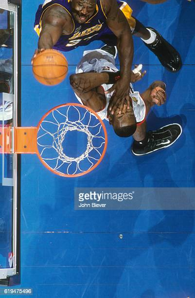 NBA Finals Aerial view of Los Angeles Lakers Shaquille O'Neal in action vs Philadelphia 76ers Dikembe Mutumbo at First Union Center Game 3...