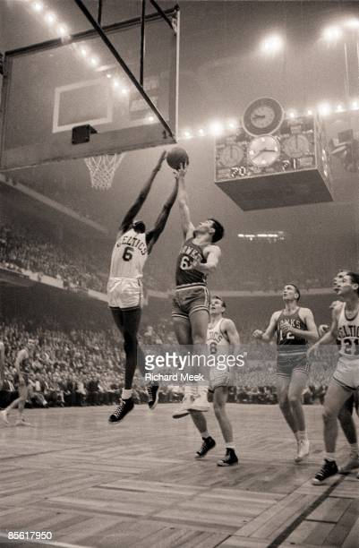 NBA Finals Boston Celtics Bill Russell in action getting rebound vs St Louis Hawks Cliff Hagan Boston MA 3/30/19574/13/1957 CREDIT Richard Meek