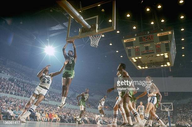 NBA Finals Boston Celtics Bill Russell in action rebound vs Los Angeles Lakers Elgin Baylor at the Los Angeles Memorial Sports Arena Game 3 Los...