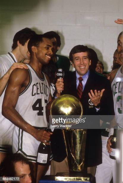 NBA Finals Boston Celtics Gerald Henderson victorious with Larry O'Brien Championship Trophy in locker room during media interview with CBS Sports...