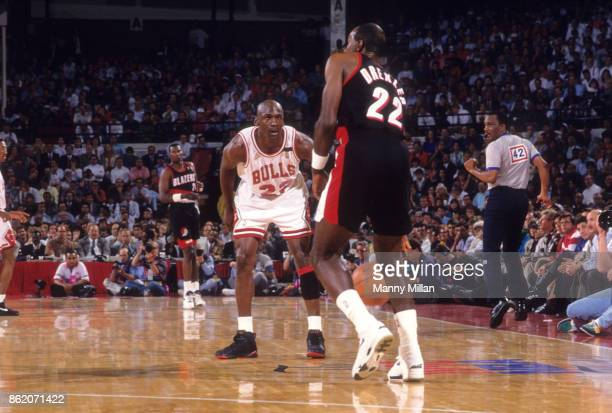 NBA Finals Chicago Bulls Michael Jordan in action defense vs Portland Trail Blazers Clyde Drexler at Chicago Stadium Game 1 Chicago IL CREDIT Manny...