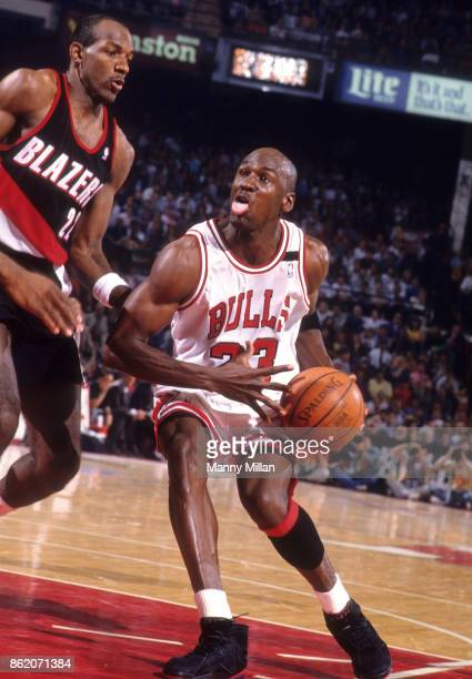 NBA Finals Chicago Bulls Michael Jordan in action vs Portland Trail Blazers Clyde Drexler at Chicago Stadium Game 2 Chicago IL CREDIT Manny Millan