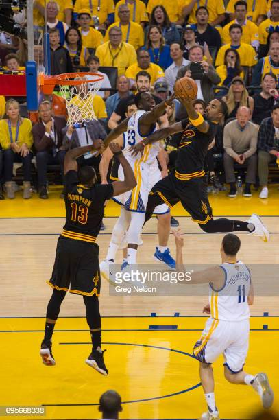 NBA Finals Cleveland Cavaliers JR Smith in action layup vs Golden State Warriors Draymond Green at Oracle Arena Game 5 Oakland CA CREDIT Greg Nelson