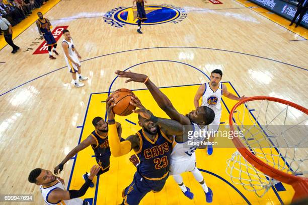NBA Finals Cleveland Cavaliers LeBron James in action vs Golden State Warriors Kevin Durant and Stephen Curry at Oracle Arena Game 1 Oakland CA...