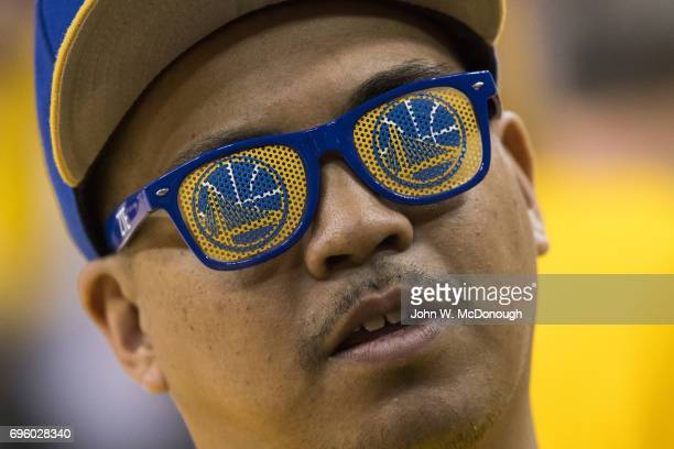 NBA Finals Closeup of fan before Golden State Warriors vs Cleveland Cavaliers at Oracle Arena Game 2 Fan wearing shades with Warriors logo Goofy...
