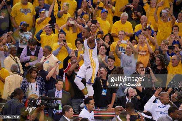 NBA Finals Golden State Warriors Andre Iguodala victorious after winning game and series vs Cleveland Cavaliers at Oracle Arena Game 5 Oakland CA...