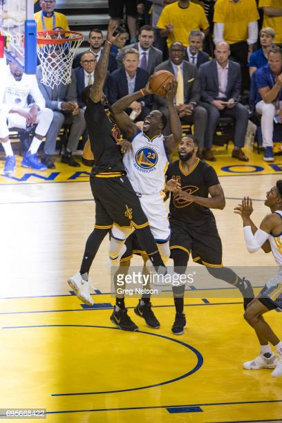 NBA Finals Golden State Warriors Draymond Green in action shot vs Cleveland Cavaliers JR Smith at Oracle Arena Game 5 Oakland CA CREDIT Greg Nelson