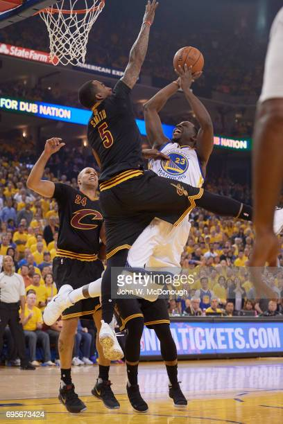 NBA Finals Golden State Warriors Draymond Green in action vs Cleveland Cavaliers JR Smith and Richard Jefferson at Oracle Arena Game 5 Oakland CA...