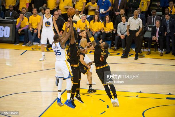 NBA Finals Golden State Warriors Kevin Durant in action shot vs Cleveland Cavaliers Tristan Thompson and JR Smith at Oracle Arena Game 5 Oakland CA...