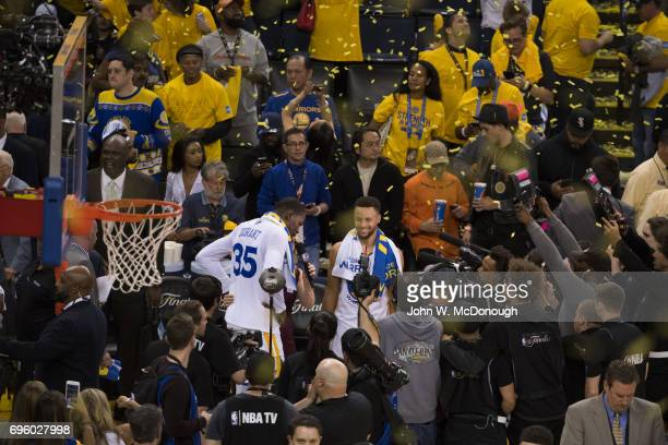 NBA Finals Golden State Warriors Stephen Curry and Kevin Durant victorious after winning game vs Cleveland Cavaliers at Oracle Arena Game 2 Oakland...
