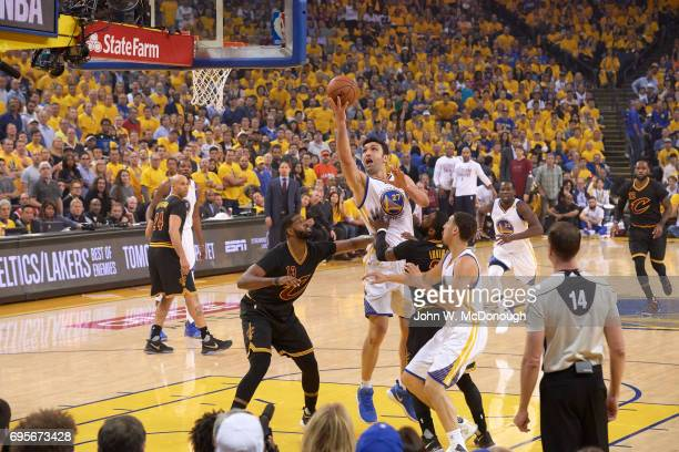 NBA Finals Golden State Warriors Zaza Pachulia in action vs Cleveland Cavaliers Tristan Thompson and Kyrie Irving at Oracle Arena Game 5 Oakland CA...