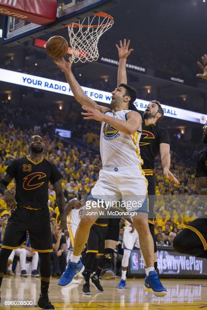 NBA Finals Golden State Warriors Zaza Pachulia in action vs Cleveland Cavaliers Kevin Love at Oracle Arena Game 2 Oakland CA CREDIT John W McDonough