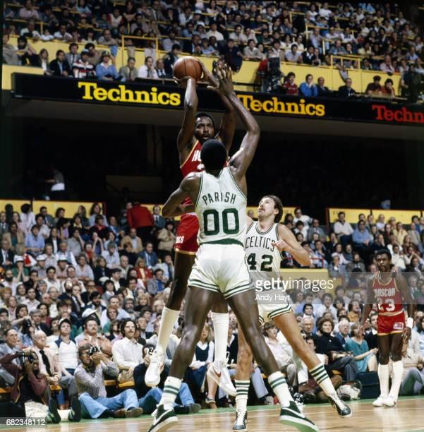 NBA Finals Houston Rockets Moses Malone in action shooting vs Boston Celtics Robert Parish and Chris Ford at Boston Garden Game 2 Boston MA CREDIT...