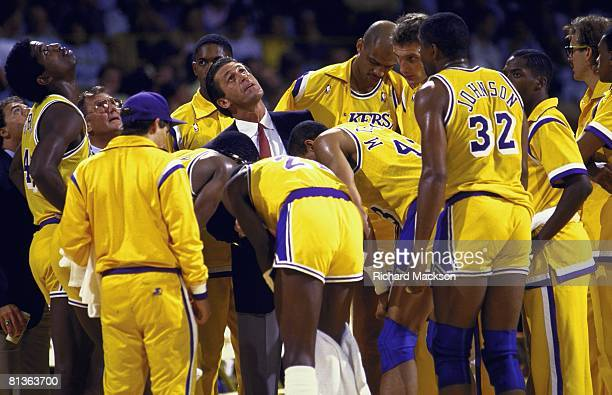 Basketball NBA finals Los Angeles Lakers coach Pat Riley in huddle with on sidelines looking up at clock during game vs Boston Celtics Los Angeles CA...