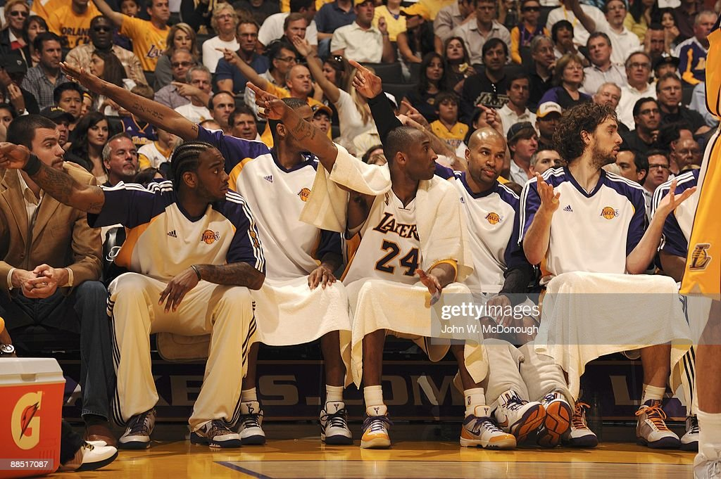 Los Angeles Lakers Josh Powell (21), Trevor Ariza (3), <a gi-track='captionPersonalityLinkClicked' href=/galleries/search?phrase=Kobe+Bryant&family=editorial&specificpeople=201466 ng-click='$event.stopPropagation()'>Kobe Bryant</a> (24), Derek Fisher (2), and Pau Gasol (16) pointing while sitting on sidelines bench during Game 2 vs Orlando Magic. Los Angeles, CA 6/7/2009