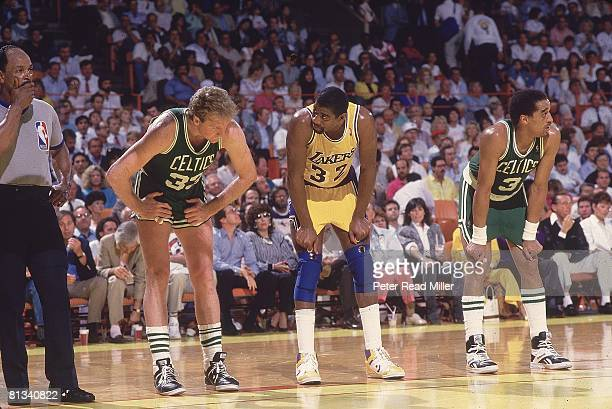 Basketball NBA Finals Los Angeles Lakers Magic Johnson during game vs Boston Celtics Larry Bird and Dennis Johnson Inglewood CA 6/2/19876/14/1987