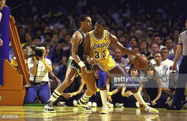 Basketball NBA Finals Los Angeles Lakers Magic Johnson in action vs Boston Celtics Dennis Johnson Game 2 Inglewood CA 6/4/1987