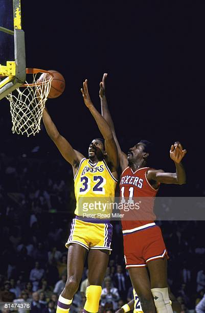 Basketball NBA finals Los Angeles Lakers Magic Johnson in action taking layup vs Philadelphia 76ers Caldwell Jones Inglewood CA 6/1/1982