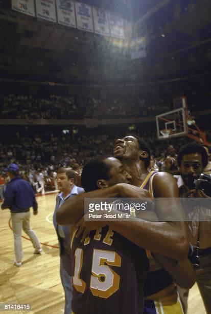Basketball NBA finals Los Angeles Lakers Magic Johnson victorious hugging teammate Butch Lee after winning Game 6 of the NBA Finals against the...