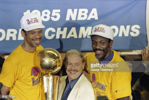 NBA Finals Los Angeles Lakers owner Jerry Buss victorious holding Larry O'Brien NBA Championship Trophy with Kareen AbdulJabbar and Bob McAdoo after...