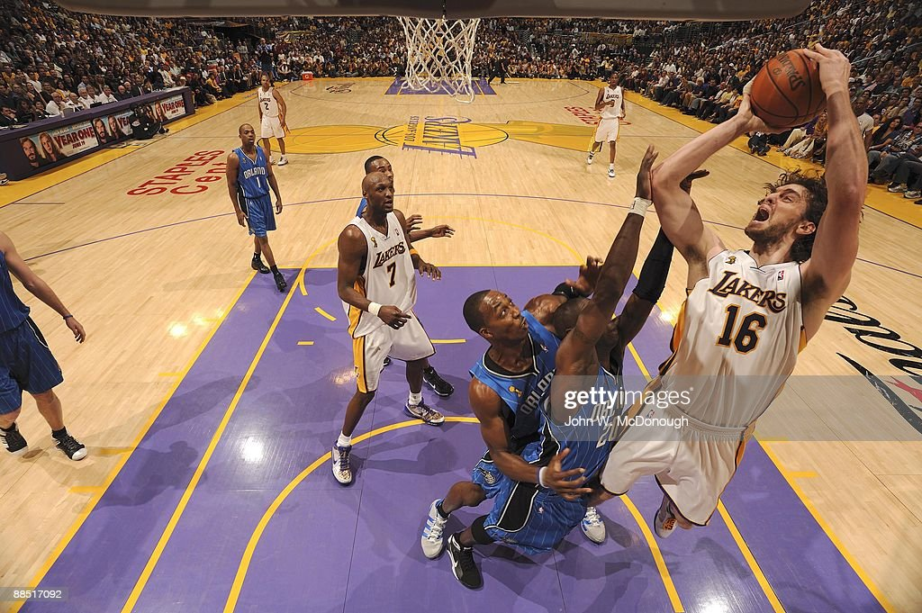 Los Angeles Lakers Pau Gasol (16) in action, shot vs Orlando Magic Mickael Pietrus (20) and <a gi-track='captionPersonalityLinkClicked' href=/galleries/search?phrase=Dwight+Howard&family=editorial&specificpeople=201570 ng-click='$event.stopPropagation()'>Dwight Howard</a> (12). Game 2. Los Angeles, CA 6/7/2009