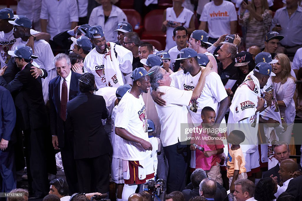 Miami Heat LeBron James (6) and team owner Micky Arison victorious after winning Game 5 and series championship vs Oklahoma City Thunder at American Airlines Arena. John W. McDonough F103 )