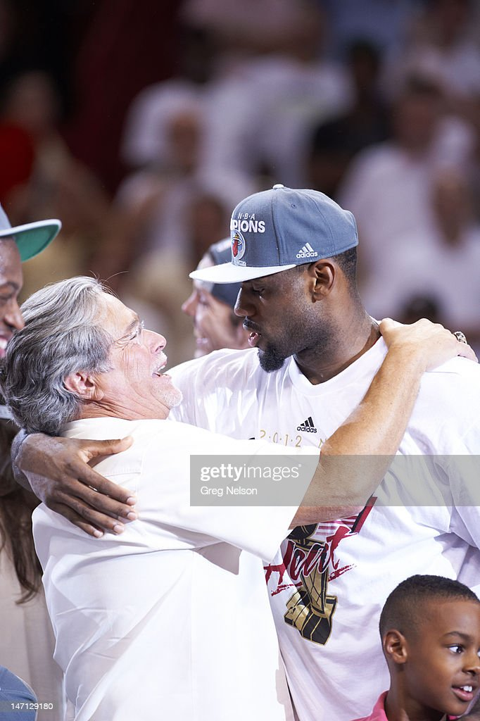 Miami Heat LeBron James (6) victorious hugging owner Micky Arison after winning game and series vs Oklahoma City Thunder at American Airlines Arena. Game 5. Greg Nelson F159 )