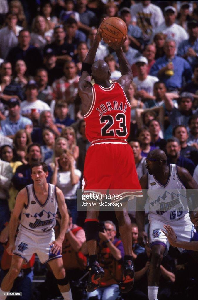Basketball NBA Finals Rear view of Chicago Bulls Michael Jordan in action making game winning shot vs Utah Jazz Game 6 Salt Lake City UT 6/14/1998