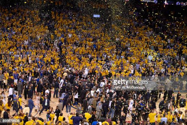 NBA Finals Rear view of Golden State Warriors Andre Iguodala victorious after winning game and series vs Cleveland Cavaliers at Oracle Arena Game 5...