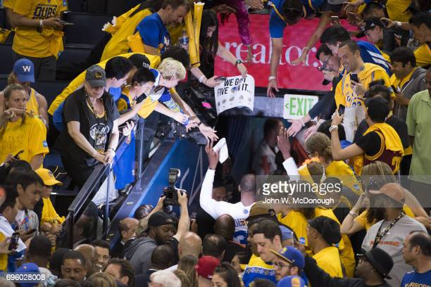 NBA Finals Rear view of Golden State Warriors Kevin Durant victorious with fans in tunnel after winning game vs Cleveland Cavaliers at Oracle Arena...