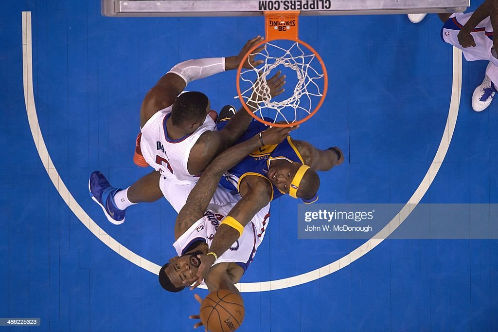 Aerial view of Golden State Warriors Jermaine O'Neal (7) in action, defense vs Los Angeles Clippers DeAndre Jordan (6) at Staples Center. Game 1. John W. McDonough TK1 )
