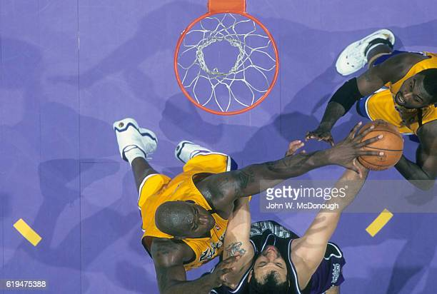 NBA Playoffs Aerial view of Los Angeles Lakers Shaquille O'Neal in action blocking shot vs Sacramento Kings Vlade Divac at Staples Center Game 1 One...