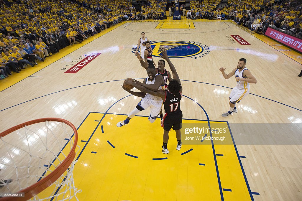 NBA Playoffs Golden State Warriors Draymond Green in action vs Portland Trail Blazers Ed Davis and AlFarouq Aminu at Oracle Arena Game 1 Oakland CA...