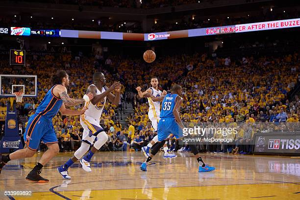 NBA Playoffs Golden State Warriors Stephen Curry in action passing to Draymond Green vs Oklahoma City Thunder Kevin Durant and Steven Adams at Oracle...