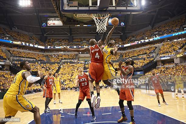 NBA Playoffs Indiana Pacers Lance Stephenson in action dunking vs Atlanta Hawks Paul Millsap at Bankers Life Fieldhouse Game 7 Indianapolis IN CREDIT...