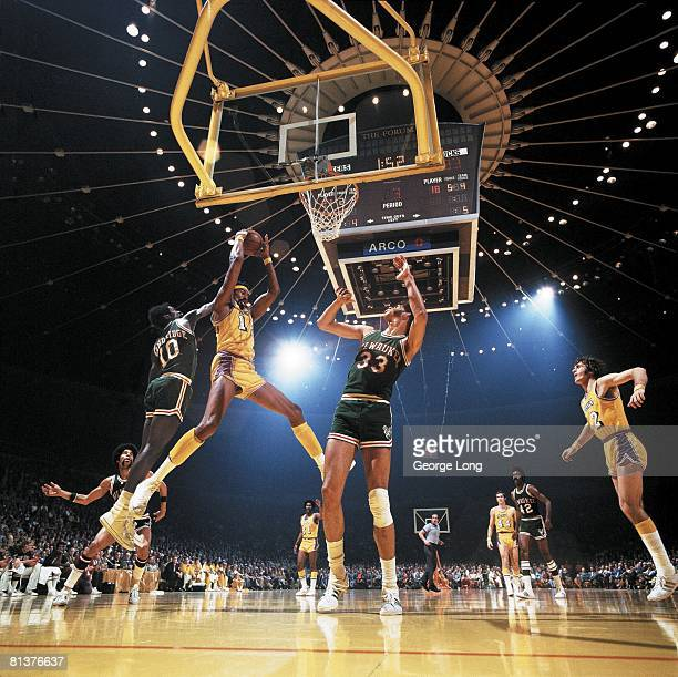 Basketball NBA Playoffs Los Angeles Lakers Wilt Chamberlain in action vs Milwaukee Bucks Kareem AbdulJabbar and Bob Dandridge View of scoreboard at...
