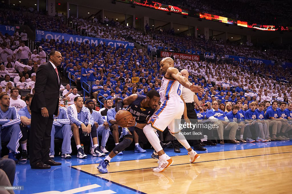 Memphis Grizzlies Mike Conley (11) in action vs Oklahoma City Thunder Derek Fisher (6) at Chesapeake Energy Arena. Game 2. Robert Beck F1739 )