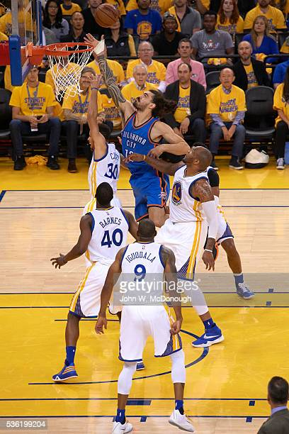 NBA Playoffs Oklahoma City Thunder Steven Adams in action vs Golden State Warriors Stephen Curry at Oracle Arena Game 5 Oakland CA CREDIT John W...