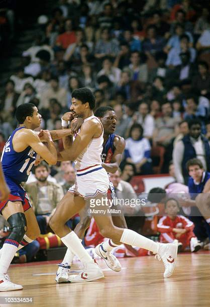 NBA Playoffs Philadelphia 76ers Julius Erving in action vs New Jersey Nets Otis Birdsong and Albert King Game 2 Philadelphia PA 4/20/1984 CREDIT...