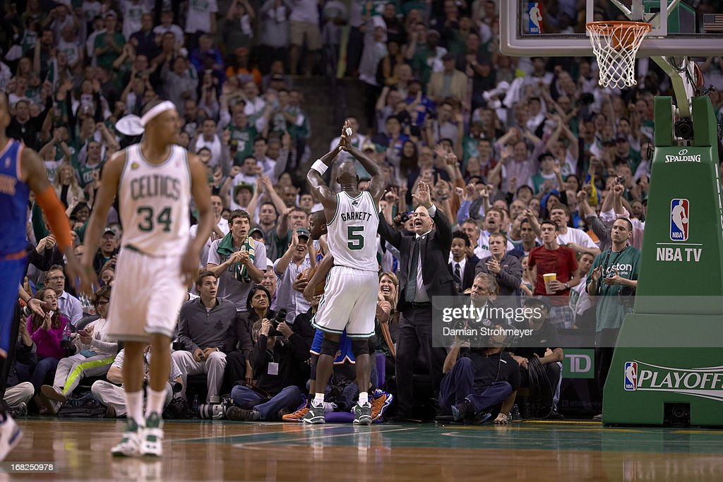 Rear view of Boston Celtics Kevin Garnett (5) victorious with fan at courtside during game vs New York Knicks at TD Garden. Game 6. Damian Strohmeyer F130 )