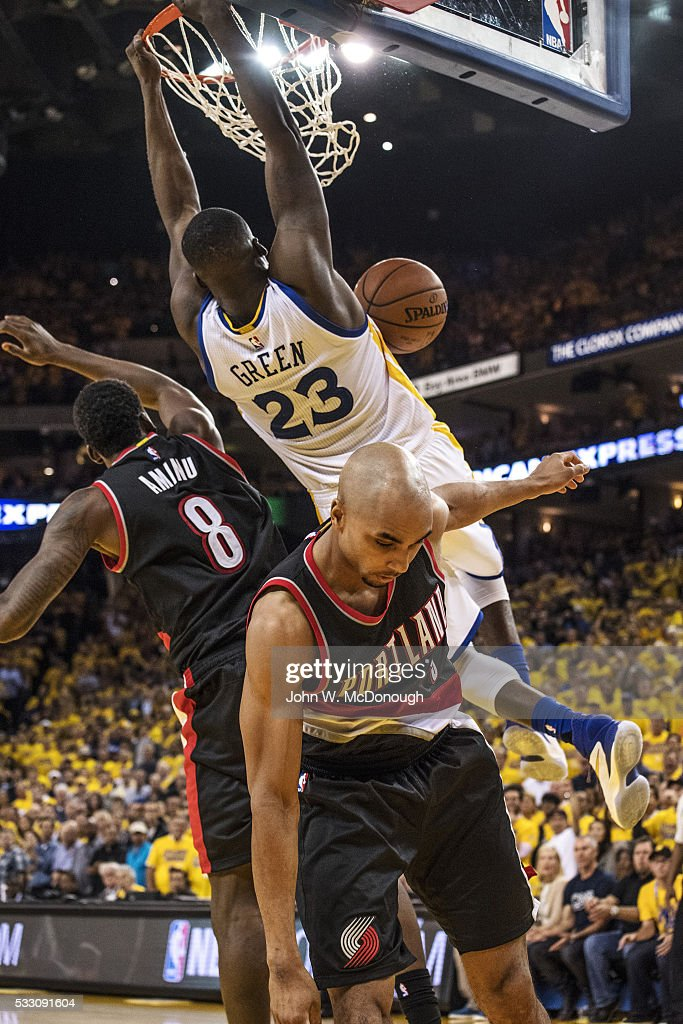 NBA Playoffs Rear view of Golden State Warriors Draymond Green in action dunk vs Portland Trail Blazers Gerald Henderson and AlFarouq Aminu at Oracle...