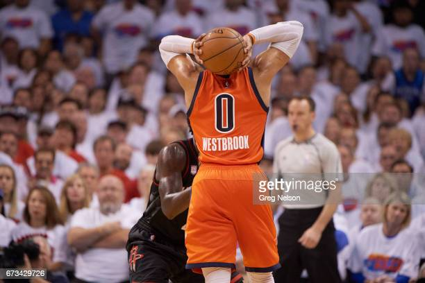 NBA Playoffs Rear view of Oklahoma City Thunder Russell Westbrook in action vs Houston Rockets at Chesapeake Energy Arena Westbrook holding ball...