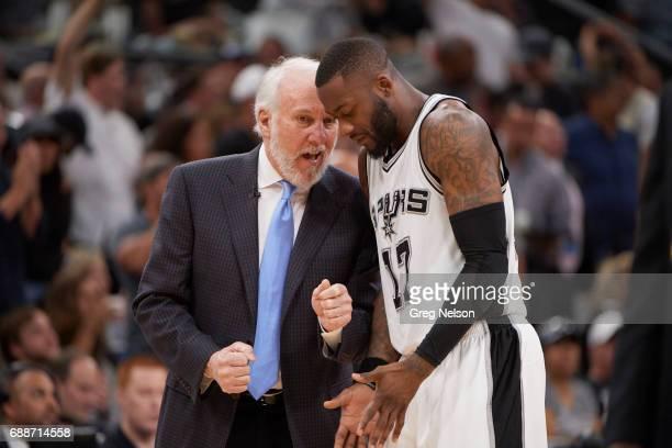 NBA Playoffs San Antonio Spurs coach Gregg Popovich with Jonathon Simmons during game vs Golden State Warriors at ATT Center Game 4 San Antonio TX...